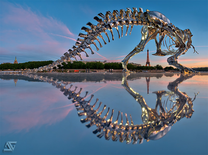 giant chrome t rex installed on the seine river in paris by philippe