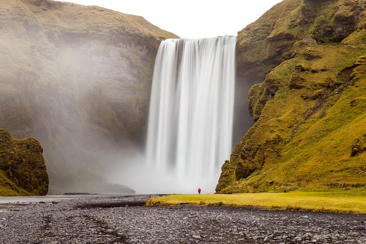 Skógafoss waterfall under Mýrdalsjökull glacier, South Icelan