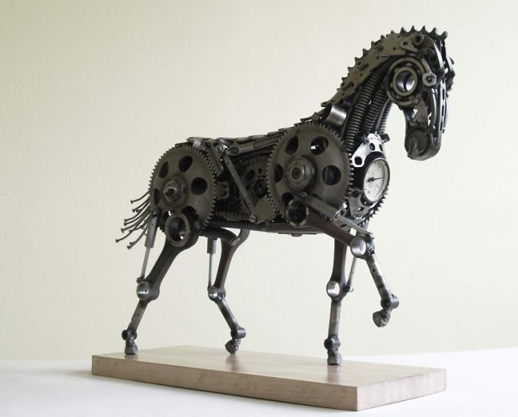 Wonderful-sculptures-created-with-recycled-motorbike-parts-16__880-750x604