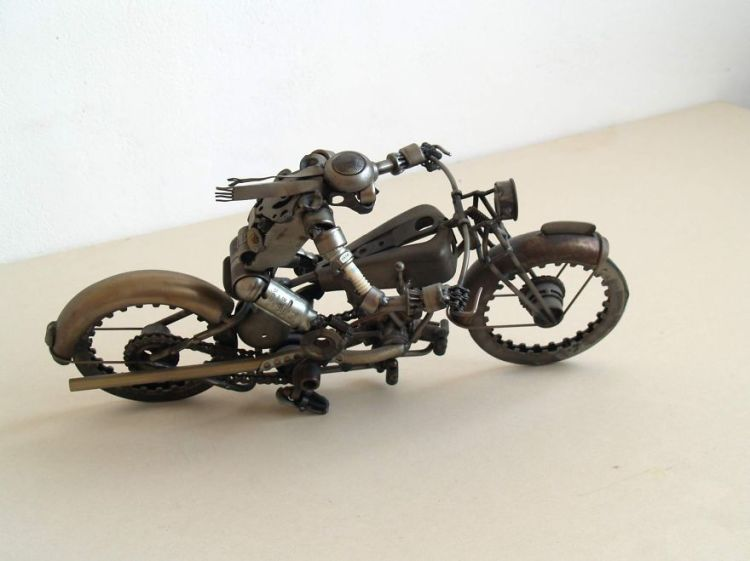 Wonderful-sculptures-created-with-recycled-motorbike-parts-3__880-750x561